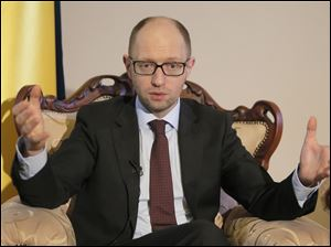 Ukrainian Prime Minister Arseniy Yatsenyuk talks with reporters during an interview with the Associated Press in Kiev, Ukraine, today.
