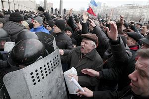 Demonstrators break police ranks to enter the regional administrative building in Donetsk, Ukraine. Hundreds of demonstrators waving Russian flags have stormed the government building in the eastern Ukraine.