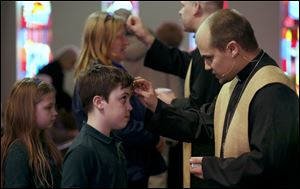 Michael Fahncke, 12, receives ashes.