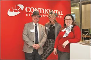 From left, Steve Kalinoski, Judy Miller, and Darcy Seely celebrate Continental Office Environments' 75th anniversary 'Mad Men' style.