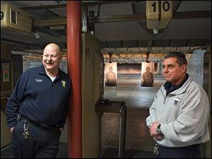Retiring Toledo police officer Roger White, left, is retiring and being replaced as armorer by fellow officer Bill Michalski. They are at the city's shooting range at the Scott Park District Station.