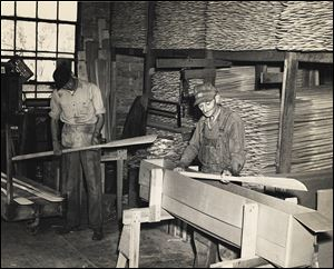 Howard Brodbeck, left, and his father, Otto Brodbeck, pack wooden oars for shipment. Stryker Boat Oar Co. was a booming business  during the late 1800s and early 1900s.