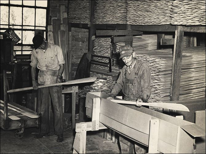 n6oar1 Howard Brodbeck, left, and his father, Otto Brodbeck, pack wooden oars for shipment. Stryker Boat Oar Co. was a booming business  during the late 1800s and early 1900s.