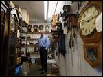 Franz Fulkerson, above, and his father Frank are there when the yearly effort to move clocks forward in the spring leads to a rash of service calls to Fulkerson Jewelers & Clock Shop in Toledo.