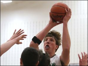 Ottawa Hills' Ottawa Hills' senior R.J. Coil (40) pulls down a rebound before putting it back up during the second quarter.