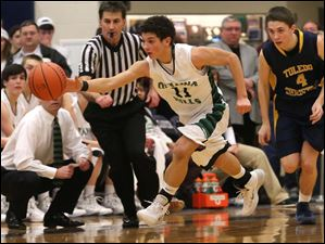 Ottawa Hills' freshman Hunter Sieben (11) steals the ball from Toledo Christian's junior Matthew Brumbaugh (4) during the second quarter.