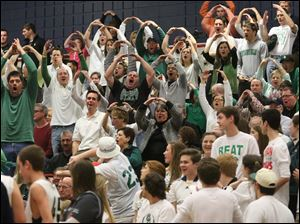 Ottawa Hills' parents get into the action during a timeout in the fourth quarter.