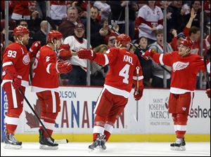 Detroit Red Wings' Brendan Smith (2) celebrates his first period goal with teammates Johan Franzen (93), of Sweden, Jakub Kindl (4), of Czechoslovakia, and Gustav Nyquist, right, of Sweden, during the first period.