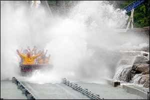 Cedar Point's Shoot the Rapids, shown here in 2010. Last summer a chain pulling one of the boats came off the track, and the boat slipped back into the water. Seven people were injured.