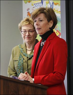U.S. Rep. Marcy Kaptur (D., Toledo) and Kathleen Falk, right, Region V director for the U.S. Department of Health and Human Services, appear at a news conference at the River East Neighborhood Health Asso-ciation. They were reminding Ohioans to enroll for health insurance bythe March 31 deadline.