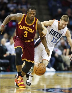 Charlotte Bobcats guard Luke Ridnour, right, fouls Cleveland Cavaliers guard Dion Waiters during the first half.