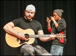Musician Chris Shutters is filmed by Toledo School for the Arts seventh grader Morgan Harrison during Shorties U at North-view High School in Sylvania.
