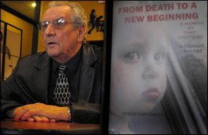 Tony Grotrian sits in in a cafe near the Hancock County Courthouse. 'We are waking up more and more people'to the dangers of drug abuse, he says . Next to Mr. Grotrian is his memoir which includes a picture of his granddaughter Amiah Alise Grotrian on the front.