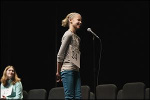 Spelling bee winner Phoebe Jackson of Woodmore Elementary said she prepared for the contest by having her mother test her with words. Katelyn Farmer of Oak Harbor, l