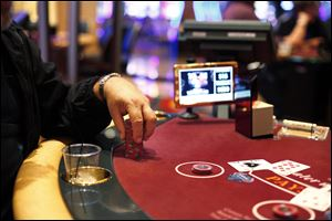A patron stacks his chips while playing blackjack at Hollywood Casino Toledo.