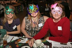 Cher Harder, left, Julie Rittenhouse, center, and Kay Morgan, all of Sylvania, donned their masks at the Pardi Paws Mardi Gras Party to benefit the Toledo Animal Shelter.