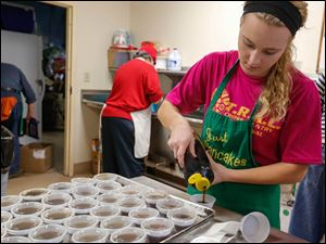 Rachael Kuecher, 17, of Oregon pours syrup for the to go orders. Kuecher began volunteering after learning about the program from Knute Huber.