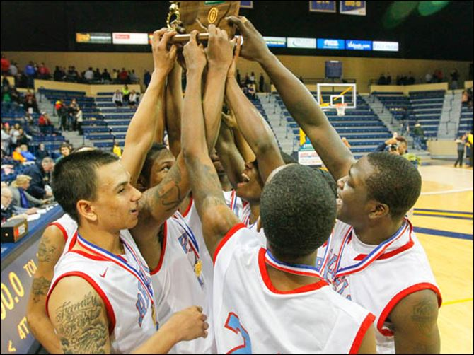 SPT UTdistrictfinal9p Bowsher High School players celebrate with their trophy after defeating St. John's Jesuit.
