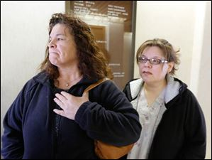 Marta Dominguez, left, and Virginia Sanchez, of Clyde, outside of the courtroom after Igmidio Mista's first appearance. Dominguez is the mother of Ramiro Arreola, 25,  who was injured in the Saturday night shooting and the aunt of Elmore police Officer Jose Andy Chavez, 26, who was killed.