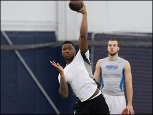 Terrence Owens throws passes to a variety of receivers for pro day.