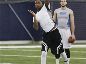 Former Rocket Terrence Owens was on the mark at pro day, completing all but one of his pass attempts.