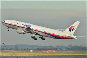 This photo provided by Laurent Errera taken Dec. 26, 2011, shows the Malaysia Airlines Boeing 777-200ER that disappeared from air traffic control screens Saturday, taking off from Roissy-Charles de Gaulle Airport in France.