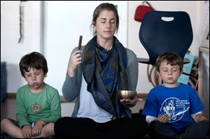 Kindergarten teacher Erica Eihl gets her students to use their senses while doing a meditation exercise at Citizens of the World Mar Vista in Culver City, Calif.