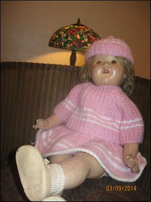 This Shirley Temple doll is showing her age, but she remains a source of memories and joy.