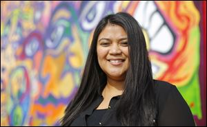 Guisselle Mendoza, new executive director of Adelante, has six years experience with the financially strapped agency.