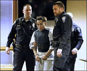 Igmidio 'Roger' Mista is escorted into Fremont Municipal Court for his arraignment Monday on three counts of murder.