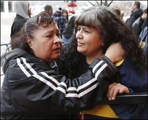 Ignacia Sanchez of Fremont, left, and Julia Sanchez of Woodville console each other during a vigil outside of the Last Call Bar for Julia Sanchez's son, Ramiro 'Ronnie' Sanchez, 28, who was killed early Sunday while working at the bar in Fremont. He was one of three slain; another person was injured.