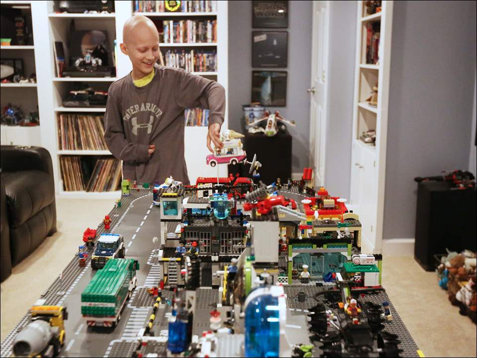 Gavin Boggs, 10, displays the Lego village he crafted in the basement of his family's home in Rossford.