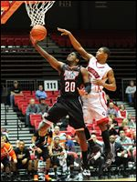 Bowling Green's Jehvon Clarke goes strong to the hoop during the team's 54-51 overtime loss to NIU in DeKalb, Ill.