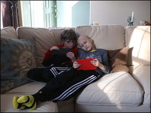 Zachary and his brother Gavin, right, play