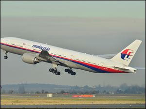 The Malaysia Airlines Boeing 777-200ER that disappeared from air traffic control screens Saturday, is shown taking off from Roissy-Charles de Gaulle Airport in France in 2011.
