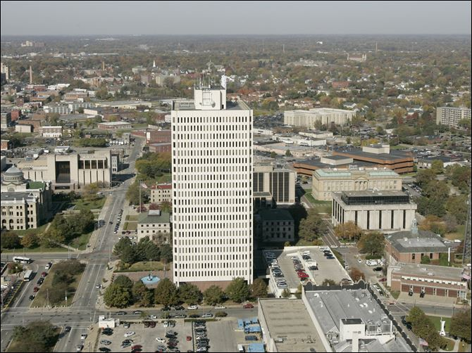CTY Toledo one government center Neither the city nor the county is technically behind in rent for space at One Government Center because the Ohio Department of Administrative Services hasn't billed for rent since July 1, officials said.