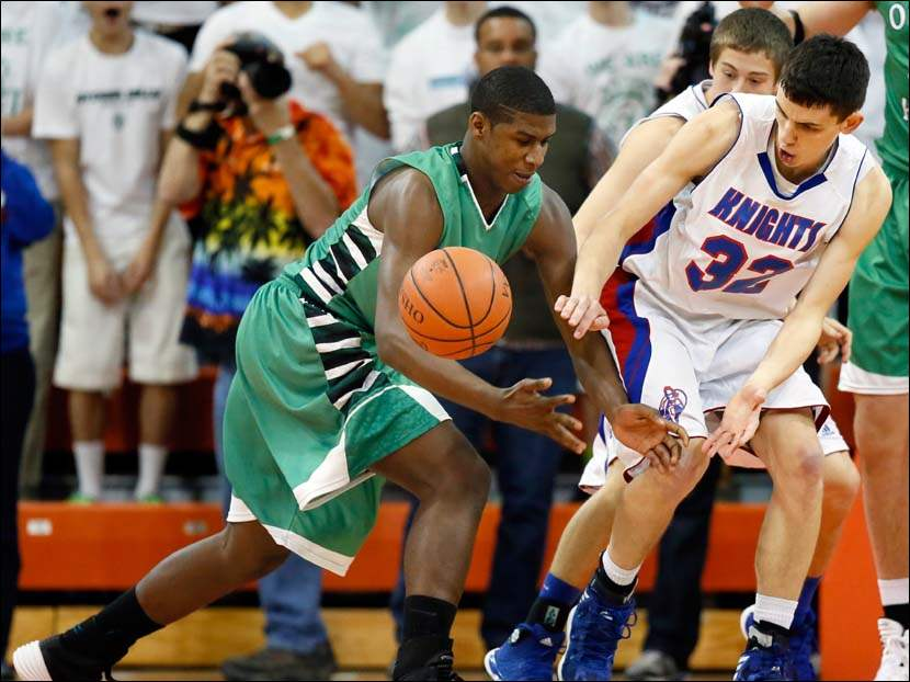 Convoy Crestview's Tyson Bolenbaugh (32) knocks the ball away from Ottawa Hills' Ellis Cummings (44).