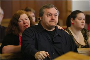 James Spaulding, father of Beth Spaulding Risenburg, 31,reacts during the sentencing of Jason Risenburg. Risenburg pleaded guilty to involuntary manslaughter in his wife's death.