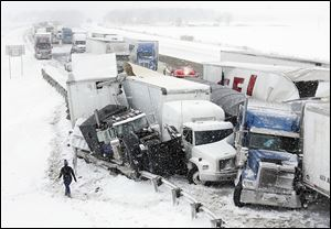 Dozens of vehicles were involved in this winter's deadliest traffic crash, which killed three people and shut down the Ohio Turnpike for hours starting about 1:05 p.m. in eastern Sandusky County.