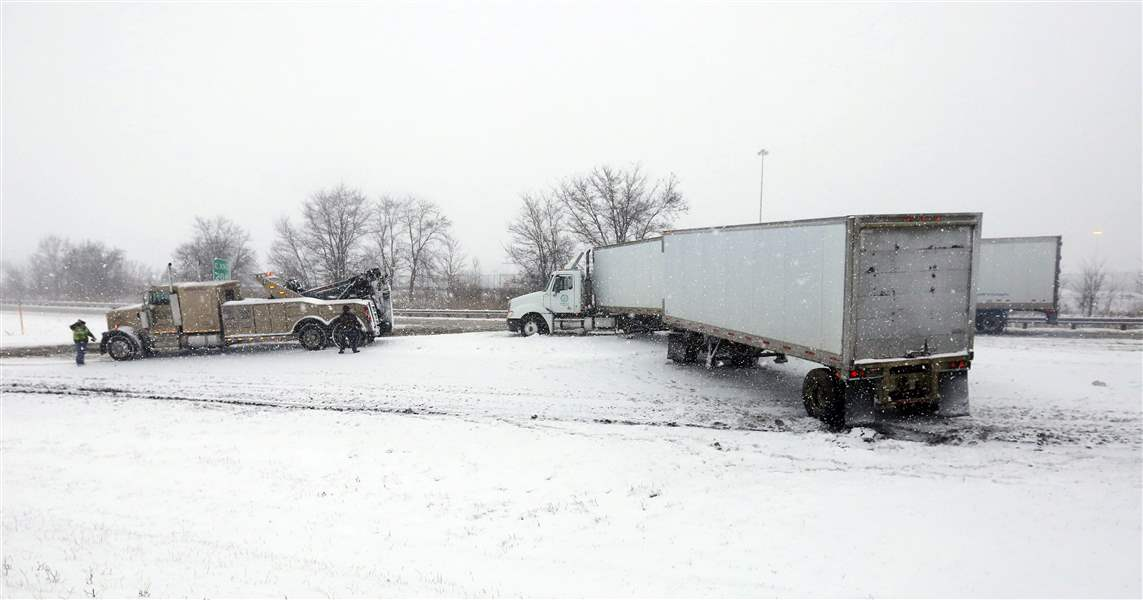 CTY-weather12p-semi-and-tow-truck