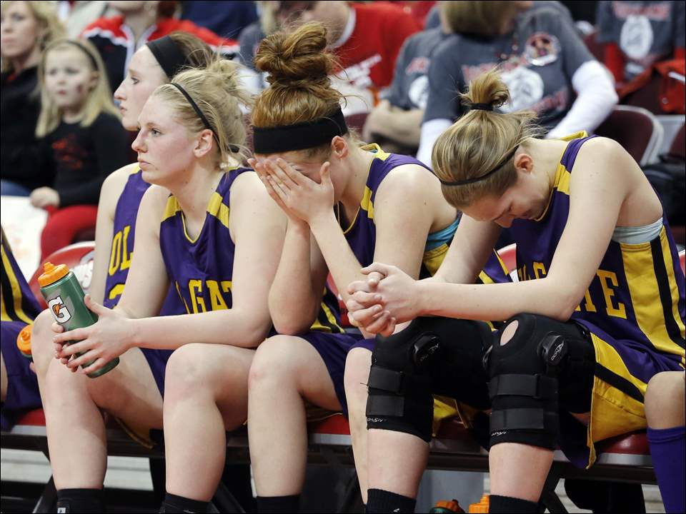 Left to right Holgate's Jillian Cady (23), Sarah Niese (24), and Marissa Myles (15) react to losing against Zanesville.