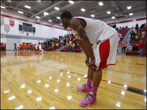 Bowsher High School player Nate Allen watches the Mansfield Senior High School team celebrate their win over the Rebels.