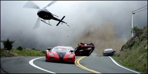 "A race scene from ""'Need For Speed.'"