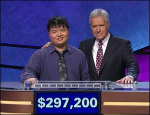 'Jeopardy!' host Alex Trebek with contestant Arthur Chu with a display of the former champion's winning on the show.