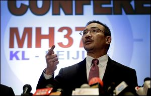 Malaysia's Minister of Transport Hishamuddin Hussein takes questions from the media during a news conference about the missing Malaysia Airlines jetliner MH370, today in Sepang, Malaysia.