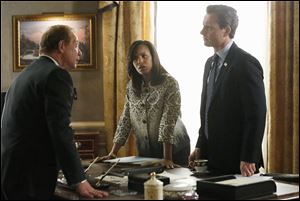 Kerry Washington, in this scene with Jeff Perry, left, and Tony Goldwyn, stars in 'Scandal,' which has a large following on social media.