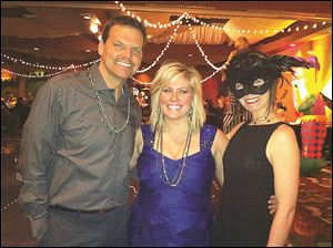 From left, Keri Samiec, Sara Swisher, and Juli Samiec attend the Mardi Gras style EPIC birthday bash.