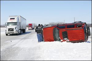 An overturned truck sits on the median between eastbound and westbound lanes on U.S. 20 near Fremont. Accidents and traffic being diverted from the turnpike led to delays on that route.