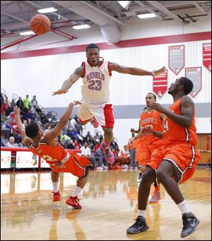 Bowsher's Nate Allen goes flying as he is fouled by Mansfield Senior's DeJorr Gibson, left. Allen led the Rebels with 22 points.