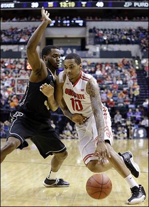 Ohio State's LaQuinton Ross drives against Purdue's Errick Peck in the second half. Ross had 19 points and 15 rebounds.